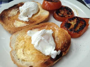 Poached Eggs for only 2.50. Side of grilled tomatoes.